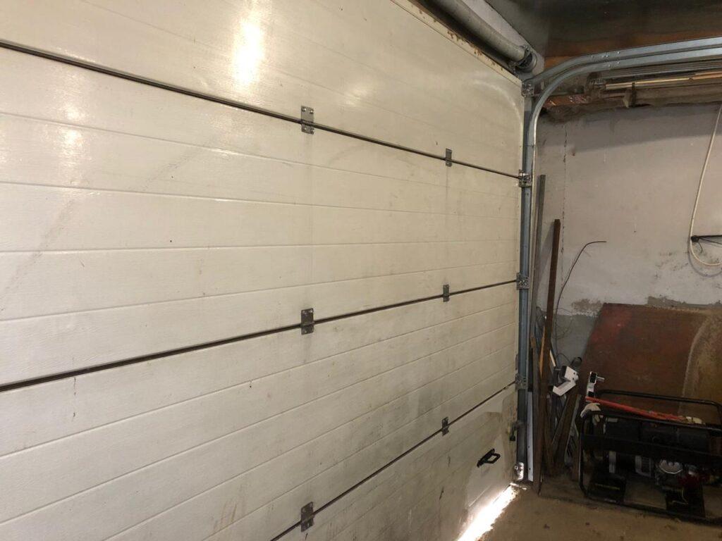 ремонт секционных гаражных ворот Alutech в Дубне